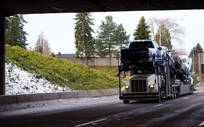 a car shipping truck moving vehicles in the winter when auto transport prices are lower