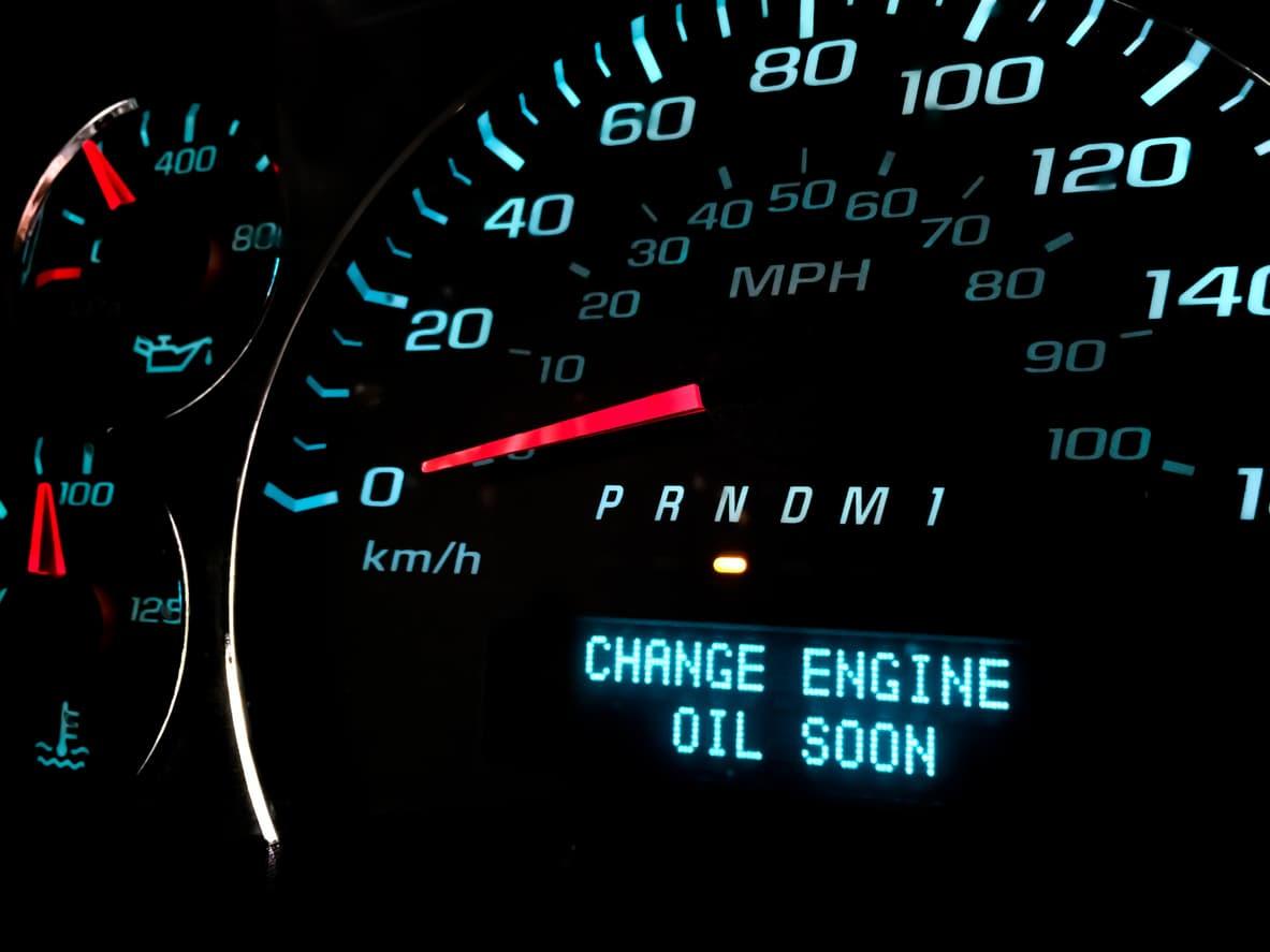 "Dashboard text alert reading ""Change engine oil soon."""